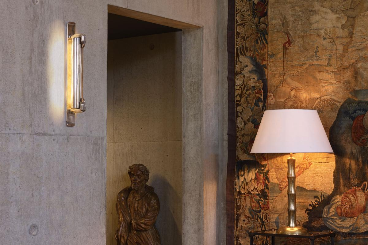 The Art Deco inspired Lang wall light. Also pictured is the Collier Webb Bamboo lamp and Carolyn table