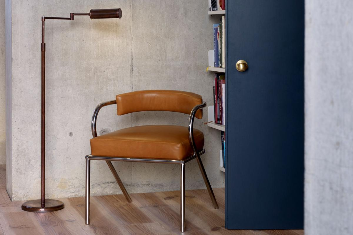The Cylinder floor light with Rene chair by Collier Webb